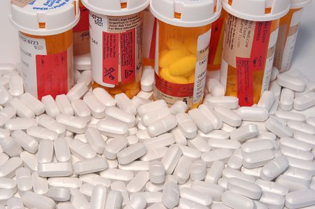 Loose prescription pills and pill bottles Stock Photo