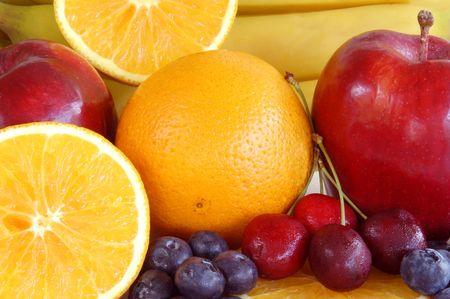 various fruits apples oranges cherries blueberries bananas Stock Photo