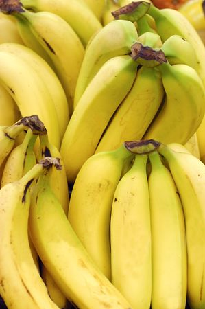 background of banana bunches for sale at the market Stock Photo