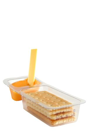 kids snack cheese spread and crackers Stock Photo