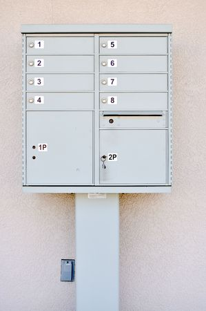 numbered complex mailboxes with locks and key Stock Photo