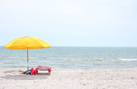 Beach landscape of sand sea and blue sky with beach umbrella chair Stock Photo