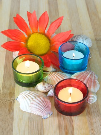 Spa concept candles seashells and flower Stock Photo