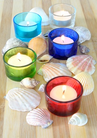 spa concept. tea candles and sea shells on bamboo Stock Photo