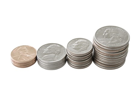 quarters, dimes, nickels and penny coin stacks isolated on white