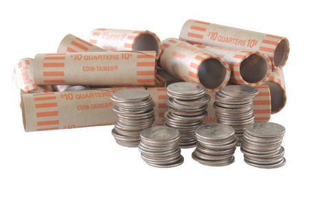stacks of quarters and empty quarter rolls isolated on white Stock Photo