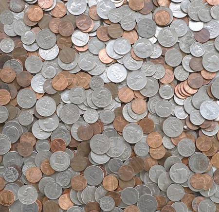 loose American coins, as background. penny, dime, nickel and quarters.