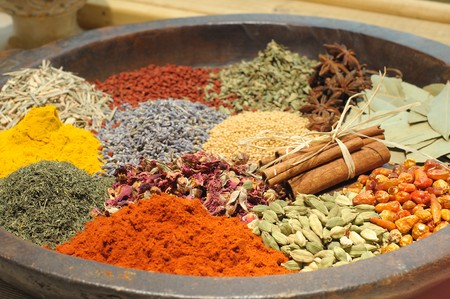 stone plate with various spices and herbs