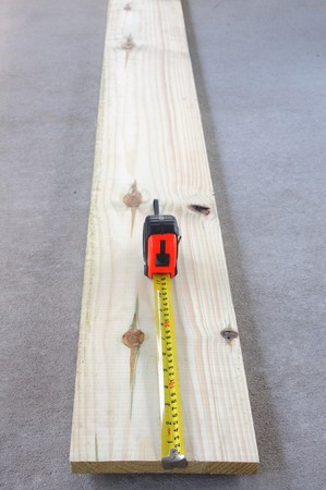 Wood plank and tape measure