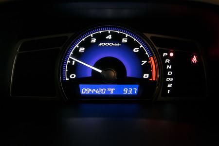 Modern car illuminated dashboard closeup Standard-Bild