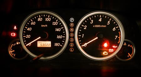 Modern car illuminated dashboard closeup photo