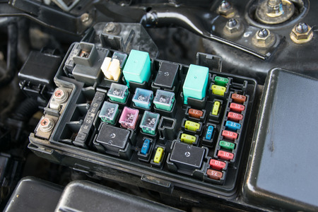 electric car: Detail of a car engine bay with fuses Stock Photo