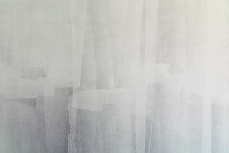 schilderen muur met verfroller Stockfoto