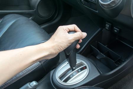 chrome man: hand on automatic gear shift, Man hand shifting an automatic car