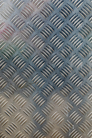 metallic grunge: metal diamond plate in silver color background Stock Photo