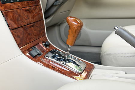 shift: Car interior decorate wood. Automatic transmission gear shift. Stock Photo