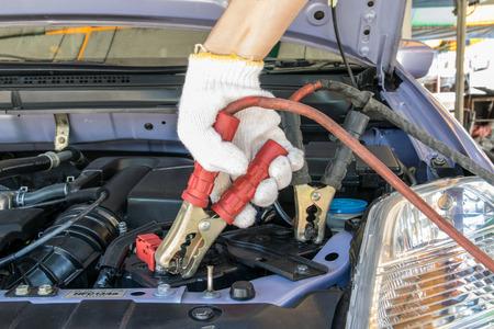 automotive technician charging vehicle battery Stock Photo