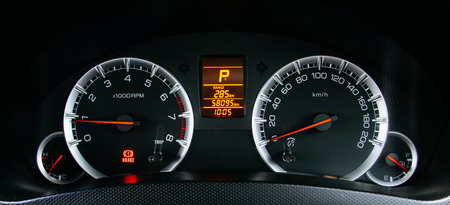 surgical needle: Modern car illuminated dashboard closeup Stock Photo