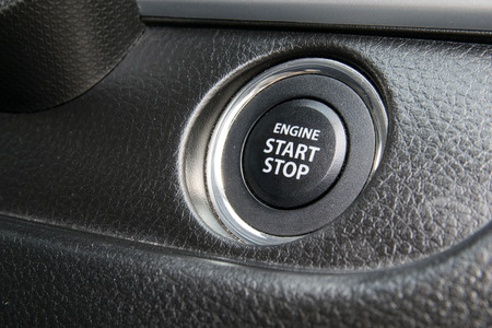 Engine start stop button from a modern car interior photo