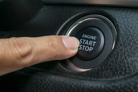 Car driver starting the engine