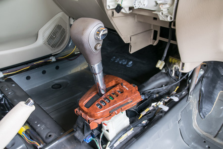 Car interior. Repair a gear shift and knob gear shift removing photo
