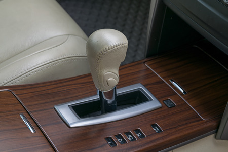 car transmission: Car interior decorate wood. Automatic transmission gear shift. Stock Photo