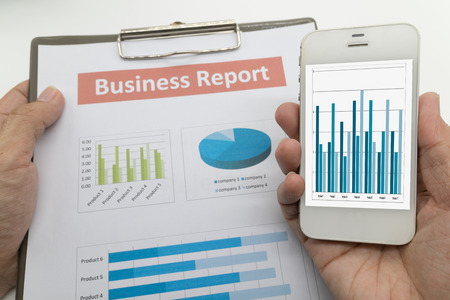 finance report: Data analyzing with smartphone, business report Stock Photo