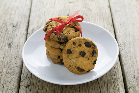 chocolate chip cookie: cookies on wooden table