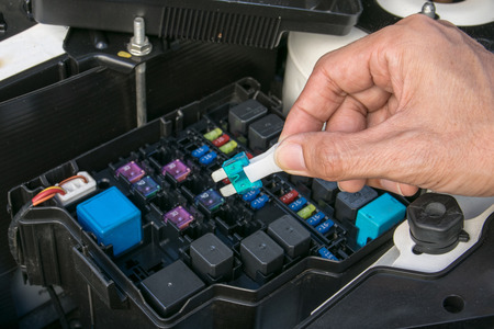 car fuse: Auto mechanic checking a car fuse