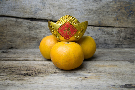 nugget: Mandarin oranges with decorative gold nugget Foreign text means Good Luck
