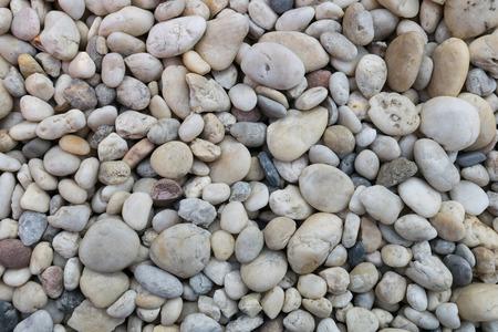 rock texture: Pebble stones on coastline Stock Photo