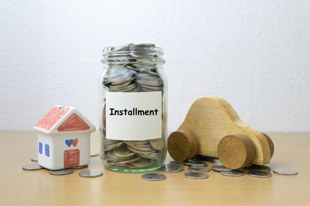 installment: Money saving for installment in the glass bottle