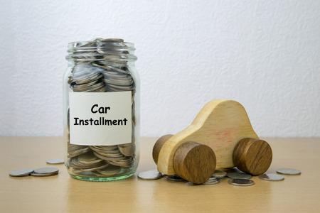 installment: Money saving for Car installment in the glass bottle Stock Photo