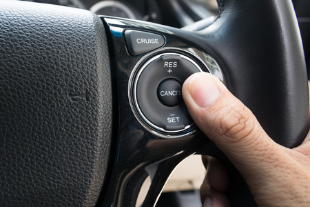 limitation: hand pushes Cruise control buttons on modern car and speed limitation