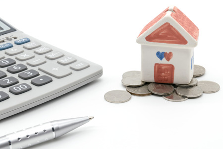 economic rent: House and calculator on white background