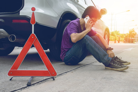 broken down: Man Phoning For Help with a broken down car