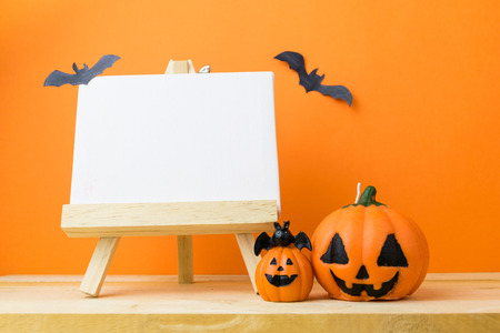 Halloween Pumpkins on wooden table Stock Photo