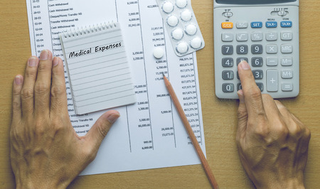 medical expenses: Man Planning Medical expenses, Finance concept
