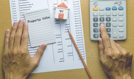 property: Man Planning monthly property valve, Finance concept Stock Photo