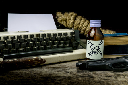 Typewriter with paper page and poison and gun. Concept writer Romance Suspense Stock Photo