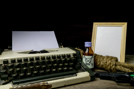 suspense: Typewriter with paper page and poison and gun. Concept writer Romance Suspense Stock Photo