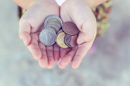 Coin in children hand. Business and finance concept Stock Photo