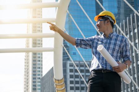 foreman: Foreman construction worker holding blueprint