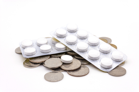medicine and coins for money concept