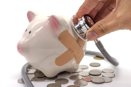 hospital fees: Doctor Holding Stethoscope to Piggy Bank