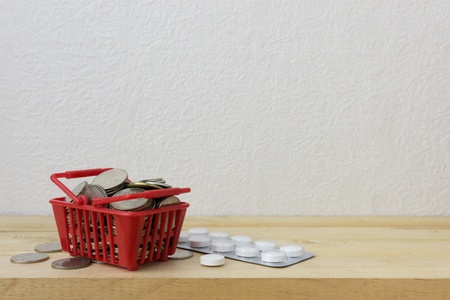 doctor money: Basket red with medicine and coins for money concept