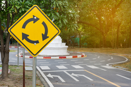 Traffic Roundabout Sign, road and signs.