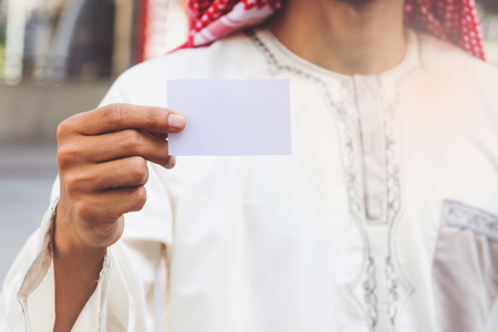 businesscard: Arab Businessman hand showing business card