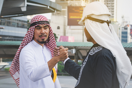 Arab businessmen worker handshaking on construction site