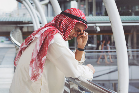 losing money: Arab Businessman is disappointed from losing in stock exchange, economic crisis concept Stock Photo